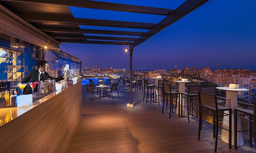 Rooftop bar and pool at night