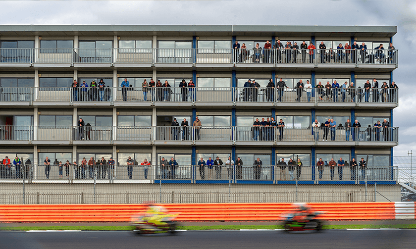 Looking back at the Brooklands Suite as bikes pass